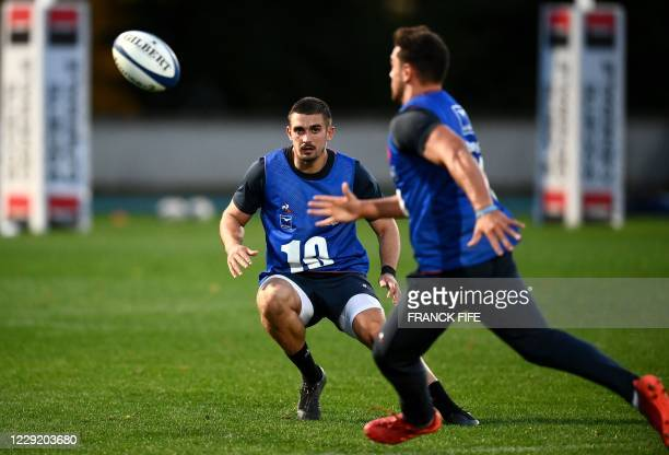 France's full back Teddy Ramos eyes the ball during a training session on October 21 2020 in Marcoussis south of Paris as part of the preparation of...