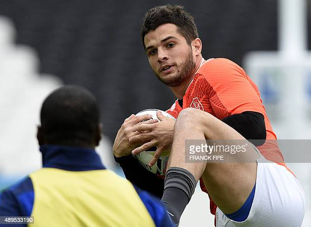 France's fullback Brice Dullin catches the ball during a team training session at the Olympic Stadium in London on September 22 on the eve of their...