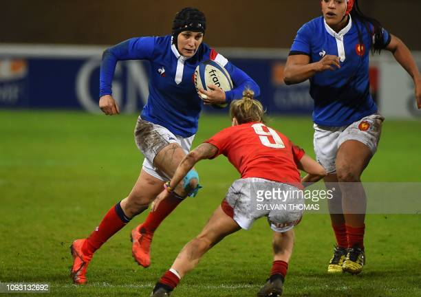 France's fullback Caroline Boujard runs with a ball during the Women's Six Nations rugby match between France and Wales at the GGL Stadium in...
