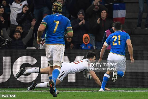France's fullback Hugo Bonneval dives and scores a try during the Six Nations international rugby union match between France and Italy at the...