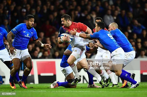 France's fullback Scott Spending vies with Samoa players during the friendly rugby test match between France and Samoa at the Stadium Municipal in...