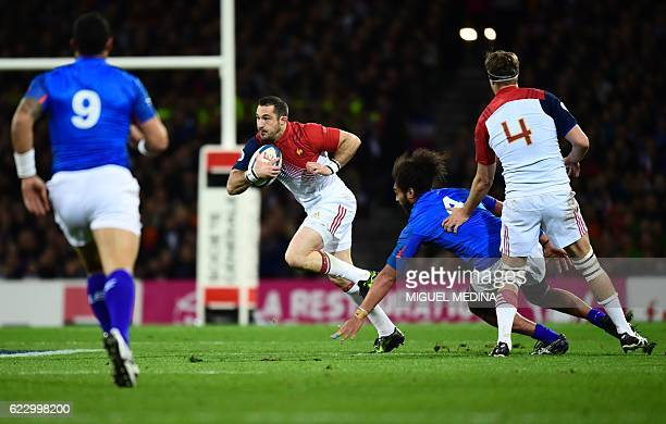 France's fullback Scott Spending vies with Samoa's second row Chris Vui during the friendly rugby test match between France and Samoa at the Stadium...