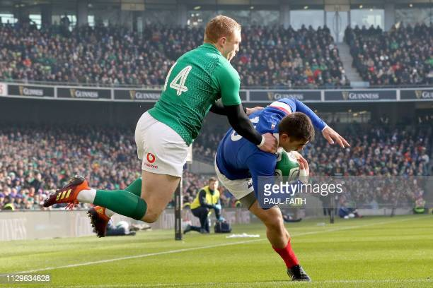 France's full-back Thomas Ramos gathers the ball under pressure from Ireland's wing Keith Earls during the Six Nations international rugby union...