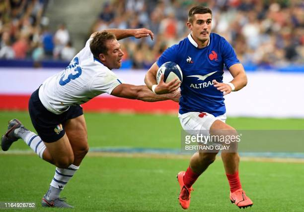 France's fullback Thomas Ramos runs past Italy's centre Tommaso Benvenuti to score a try during the international Test rugby union match between...