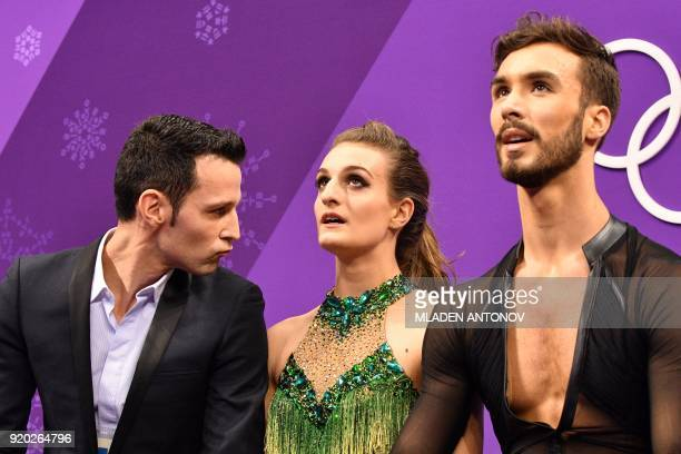 France's Gabriella Papadakis and France's Guillaume Cizeron react after competing in the ice dance short dance of the figure skating event during the...