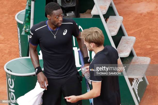 TOPSHOT France's Gael Monfils and Belgium's David Goffin argue during their men's singles third round match on day seven of The Roland Garros 2018...