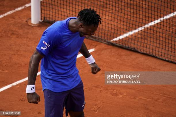 France's Gael Monfils celebrates after winning against France's Adrian Mannarino during their men's singles second round match on day five of The...