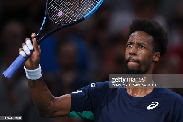 France's Gael Monfils celebrates after winning against France's Benoit Paire during their men's singles tennis match on day three of the ATP World...