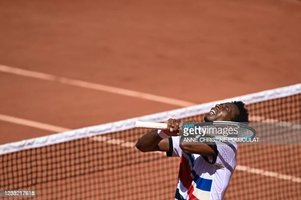 France's Gael Monfils celebrates after winning against Spain's Albert Ramos-Vinolas during their men's singles first round tennis match on Day 3 of...
