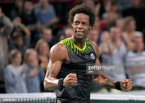 France's Gael Monfils celebrates after winning against Switzerland's Roger Federer the Paris masters 1000 ATP tournament semi final tennis match on...
