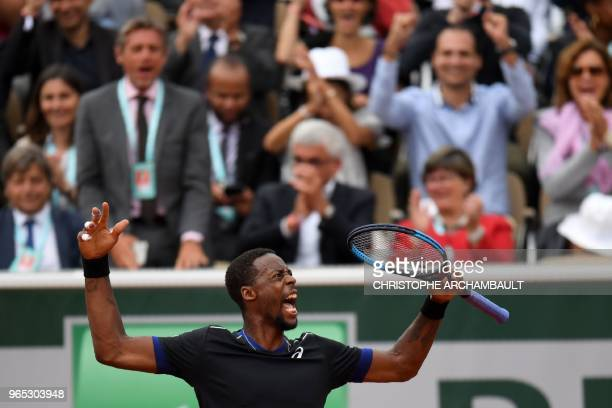 TOPSHOT France's Gael Monfils celebrates after winning the first set against Belgium's David Goffin during their men's singles third round match on...
