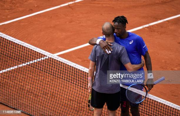 France's Gael Monfils congratulates France's Adrian Mannarino after winning in their men's singles second round match on day five of The Roland...