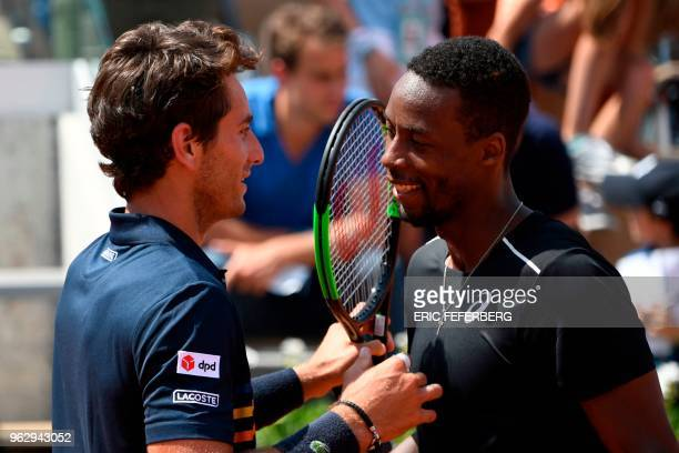 France's Gael Monfils embraces compatriot Elliot Benchetrit after victory in their men's singles first round match on day one of The Roland Garros...