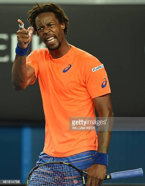 France's Gael Monfils gestures during his men's singles match against compatriot Lucas Pouille on day two of the 2015 Australian Open tennis...