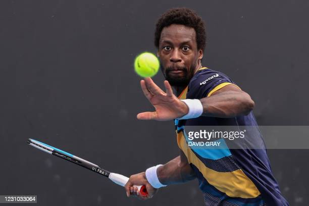 France's Gael Monfils hits a return against Finland's Emil Ruusuvuori during their men's singles match on day one of the Australian Open tennis...