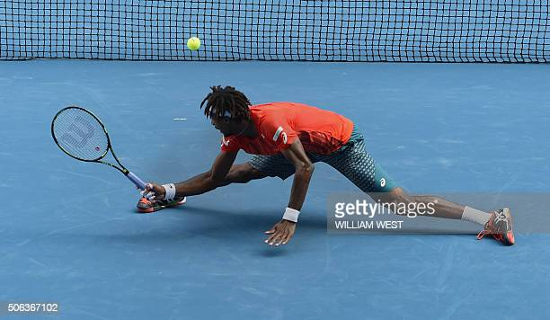 France's Gael Monfils plays a backhand return at the net during his men's singles match against compatriot Stephane Robert on day six of the 2016...