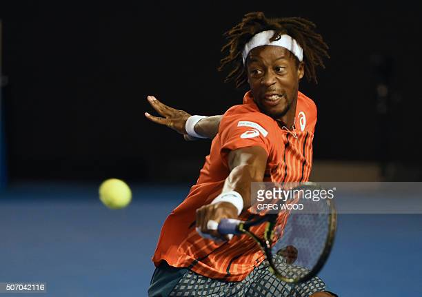 France's Gael Monfils plays a backhand return during his men's singles match against Canada's Milos Raonic on day ten of the 2016 Australian Open...