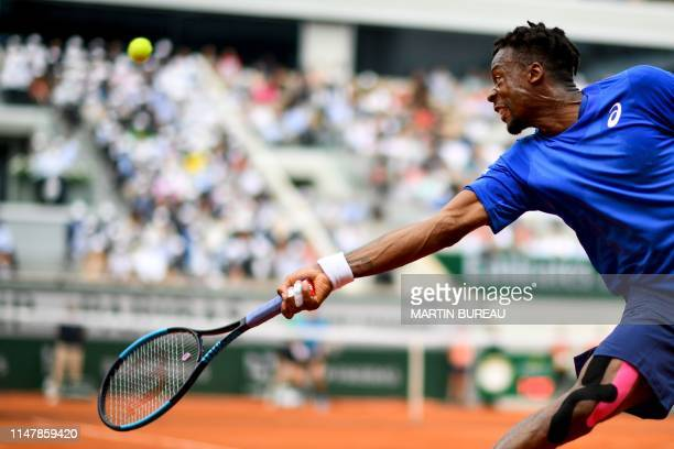 TOPSHOT France's Gael Monfils plays a backhand return to Austria's Dominic Thiem during their men's singles fourth round match on day nine of The...