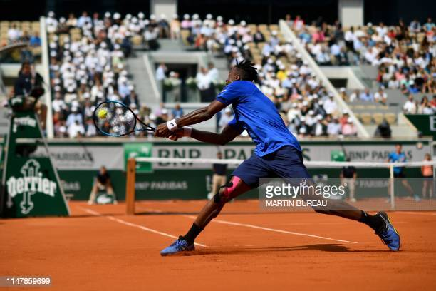 France's Gael Monfils plays a backhand return to Austria's Dominic Thiem during their men's singles fourth round match on day nine of The Roland...