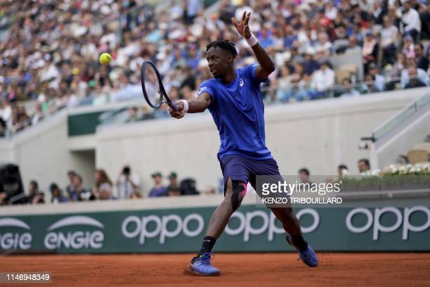 France's Gael Monfils plays a backhand return to France's Adrian Mannarino during their men's singles second round match on day five of The Roland...