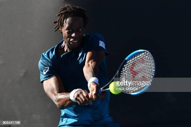 TOPSHOT France's Gael Monfils plays a backhand return to Spain's Jaume Munar during their men's singles first round match on day two of the...