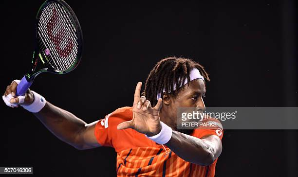 France's Gael Monfils plays a forehand return during his men's singles match against Canada's Milos Raonic on day ten of the 2016 Australian Open...