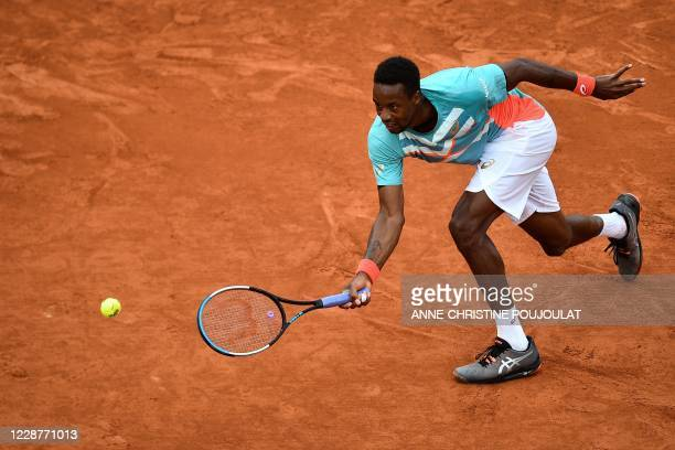 France's Gael Monfils plays a forehand return to Kazakhstan's Alexander Bublik during their men's singles first round tennis match at the Suzanne...