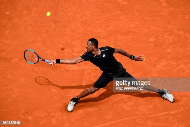 TOPSHOT France's Gael Monfils plays a return to compatriot Elliot Benchetrit during their men's singles first round match on day one of The Roland...