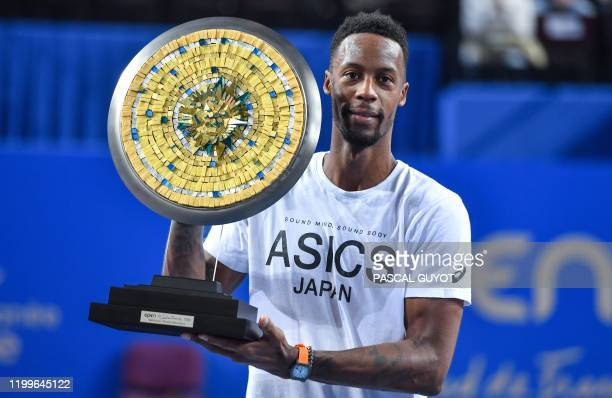 France's Gael Monfils poses with his trophy at the end of the final of the Open Sud de France ATP World Tour in Montpellier, southern France, on...