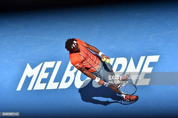 France's Gael Monfils prepares to serve against France's Stephane Robert during their men's game on day six of the 2016 Australian Open tennis...