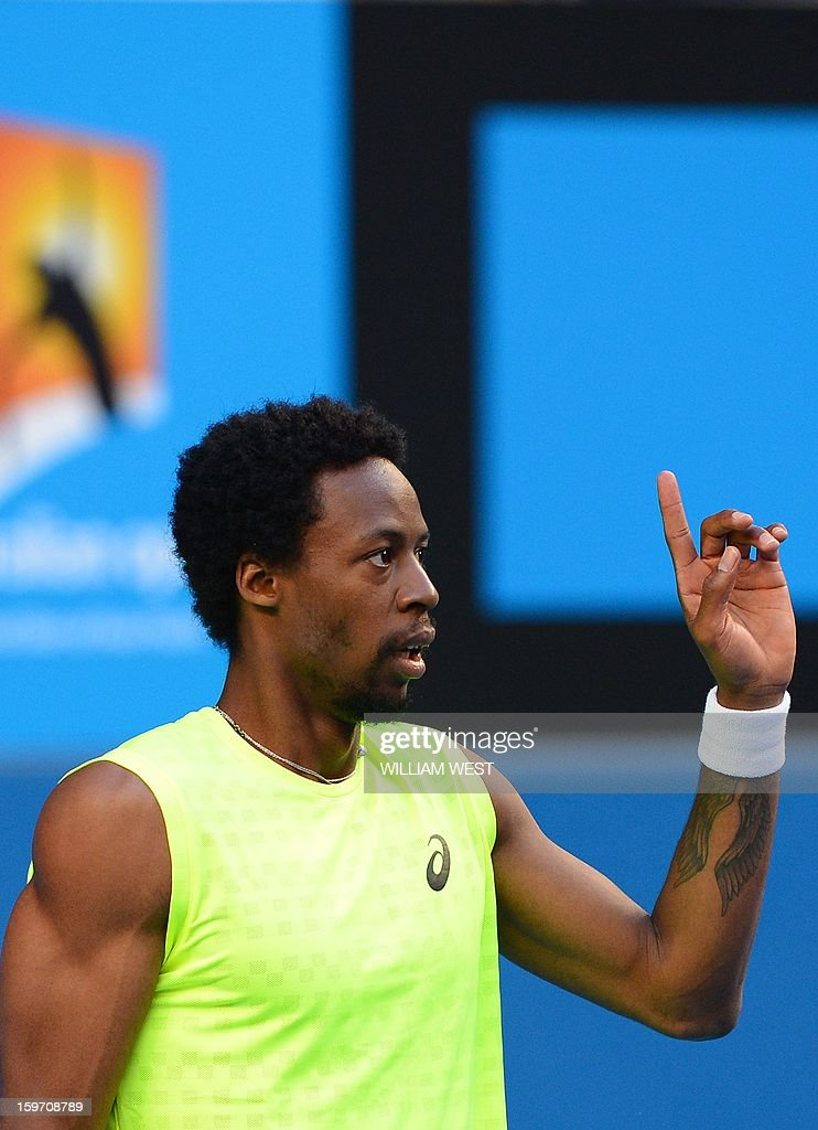 France's Gael Monfils reacts after a point against France's Gilles Simon during their men's singles match on day six of the Australian Open tennis tournament in Melbourne on January 19, 2013.