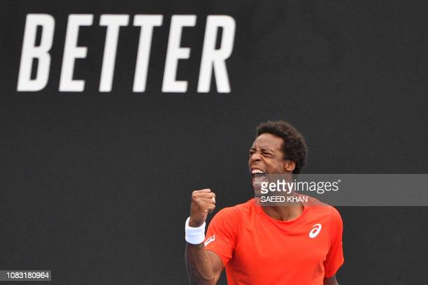 TOPSHOT France's Gael Monfils reacts after a point against Taylor Fritz of the US during their men's singles match on day three of the Australian...