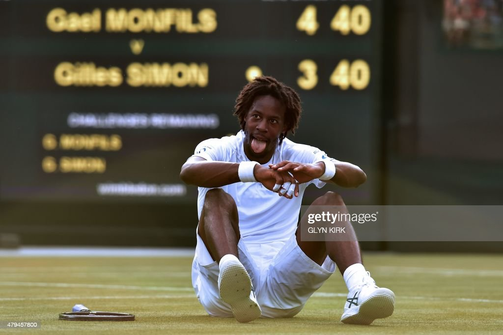 France's Gael Monfils reacts after slipping during a point against France's Gilles Simon during their men's singles third round match on day six of the 2015 Wimbledon Championships at The All England Tennis Club in Wimbledon, southwest London, on July 4, 2015. RESTRICTED