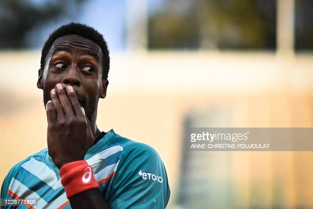 TOPSHOT France's Gael Monfils reacts as he plays against Kazakhstan's Alexander Bublik during their men's singles first round tennis match at the...