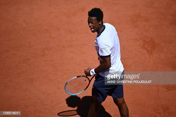 France's Gael Monfils reacts as he plays against Spain's Albert Ramos-Vinolas during their men's singles first round tennis match on Day 3 of The...