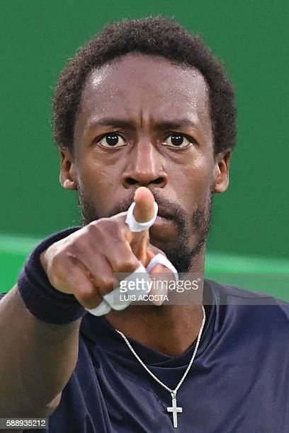 France's Gael Monfils reacts during his men's singles quarter-finals tennis match against Japan's Kei Nishikori at the Olympic Tennis Centre of the...