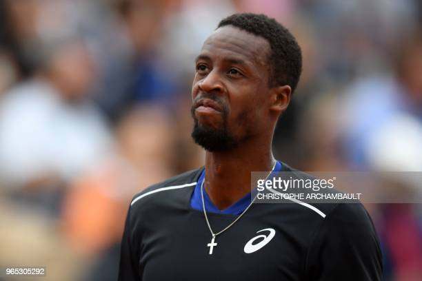 TOPSHOT France's Gael Monfils reacts during his men's singles third round match against Belgium's David Goffin on day six of The Roland Garros 2018...
