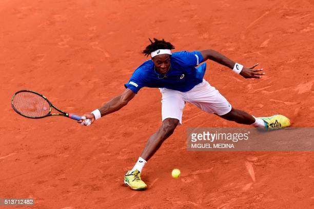 France's Gael Monfils returns a shot to Canada's Frank Dancevic during the Davis Cup World Group firstround match between France and Canada on March...