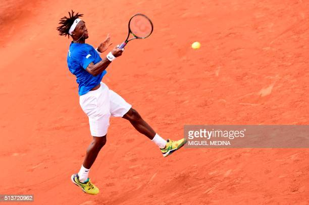 TOPSHOT France's Gael Monfils returns a shot to Canada's Frank Dancevic during the Davis Cup World Group firstround between France and Canada on...
