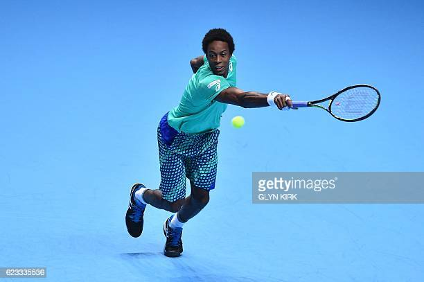 TOPSHOT France's Gael Monfils returns against Austria's Dominic Thiem during their round robin stage men's singles match on day three of the ATP...