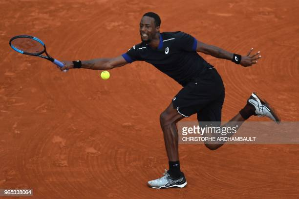 TOPSHOT France's Gael Monfils returns the ball to Belgium's David Goffin during their men's singles third round match on day six of The Roland Garros...