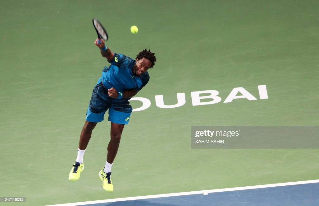 France's Gael Monfils returns the ball to Fernando Verdasco of Spain during their ATP quarter-final tennis match as part of the Dubai Duty Free Championships on March 2, 2017, in Dubai. /