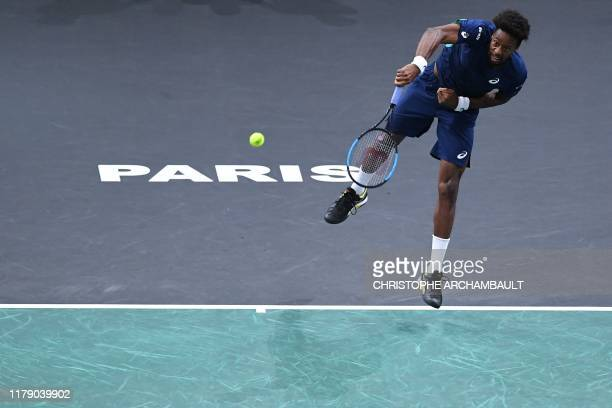 France's Gael Monfils returns the ball to France's Benoit Paire during their men's singles tennis match on day three of the ATP World Tour Masters...