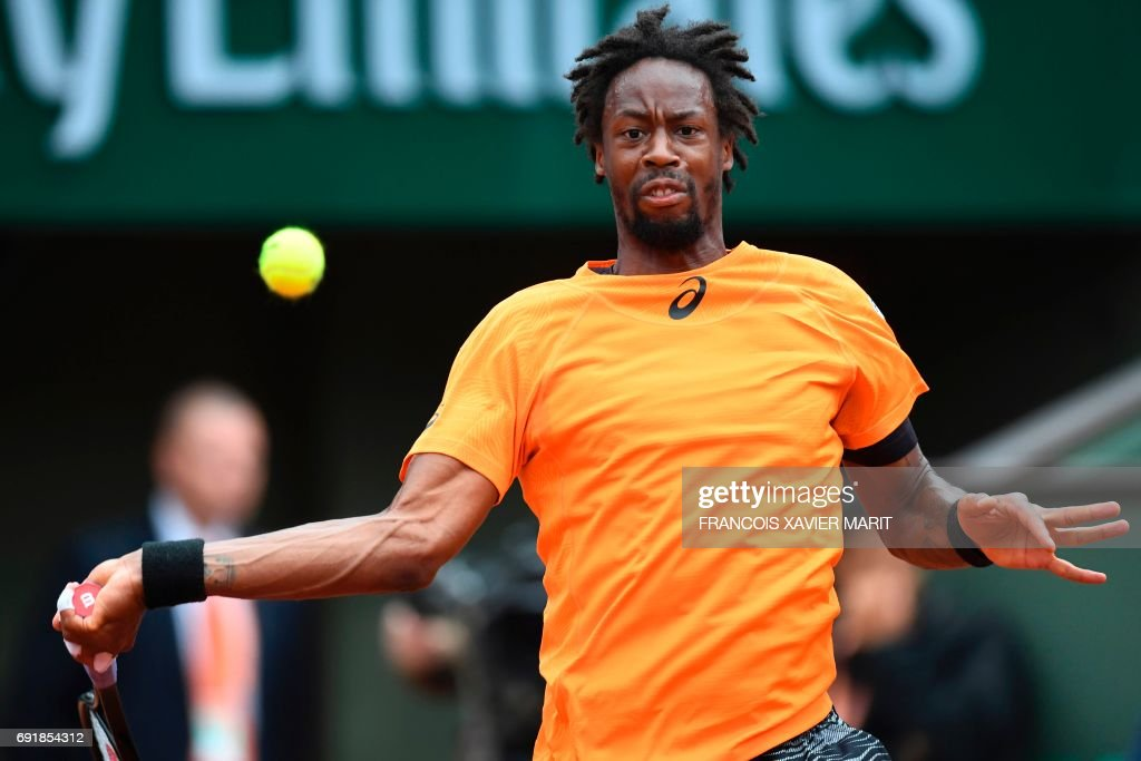 France's Gael Monfils returns the ball to France's Richard Gasquet during their tennis match at the Roland Garros 2017 French Open on June 3, 2017 in Paris. /