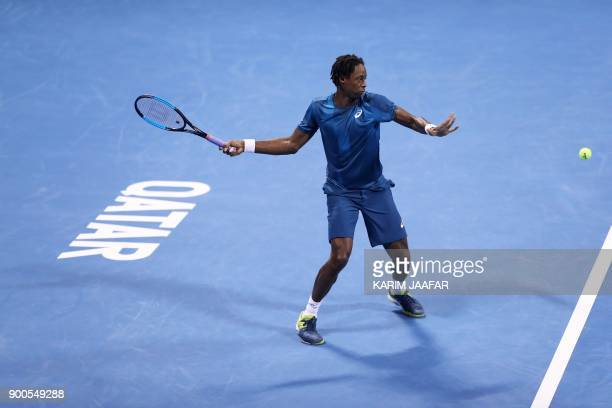 TOPSHOT France's Gael Monfils returns the ball to Italy's Paolo Lorenzi during the first round of the ATP Qatar Open tennis competition in Doha on...