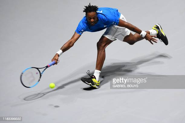 France's Gael Monfils returns the ball to Japan's Yoshihito Nishioka during the singles tennis match between France and Japan at the Davis Cup Madrid...
