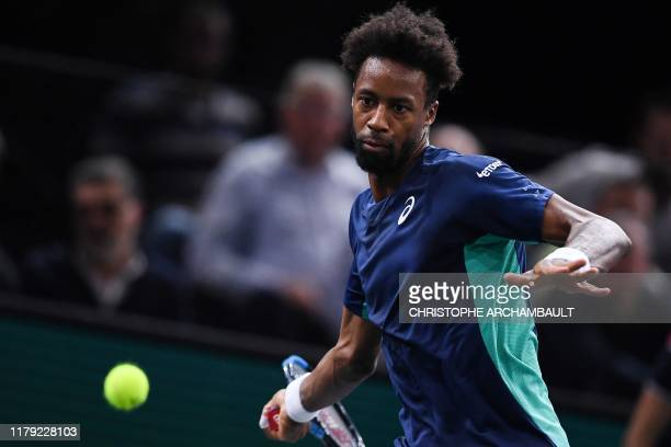 France's Gael Monfils returns the ball to Moldova's Radu Albot during their men's singles tennis match on day four of the ATP World Tour Masters 1000...