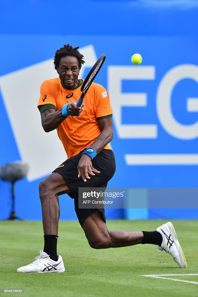France's Gael Monfils returns to France's Richard Gasquet during their men's semi-final tennis match at the ATP Aegon International tennis tournament in Eastbourne, southern England, on June 30, 2017. / AFP PHOTO / Glyn KIRK