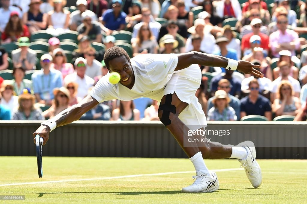 TOPSHOT - France's Gael Monfils returns to US player Sam Querrey in their men's singles third round match on the fifth day of the 2018 Wimbledon Championships at The All England Lawn Tennis Club in Wimbledon, southwest London, on July 6, 2018. (Photo by Glyn KIRK / AFP) / RESTRICTED