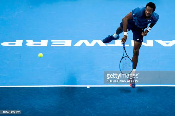 France's Gael Monfils serves the ball to Britain's Kyle Edmund during their ATP World Tour 250 European Open men's singles final tennis match in...